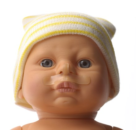 Face of baby doll wearing NEO-prep Neonatal CPAP Skin Barrier